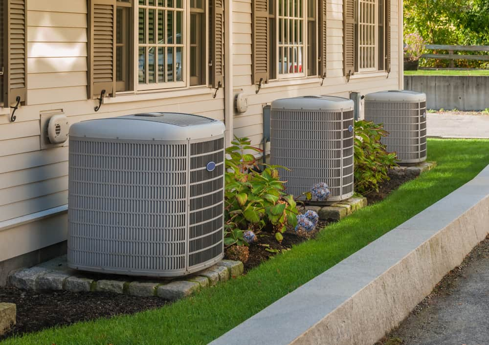 Heating,And,Air,Conditioning,Inverters,On,The,Side,Of,A